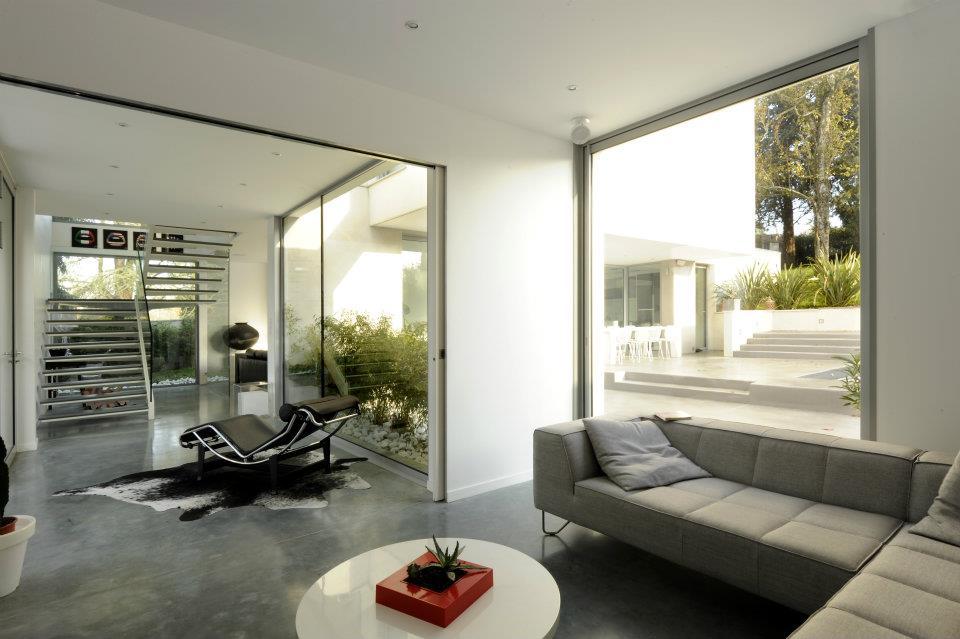 Maison sdp construction d 39 une maison haut de gamme for Salon ouvert sur terrasse